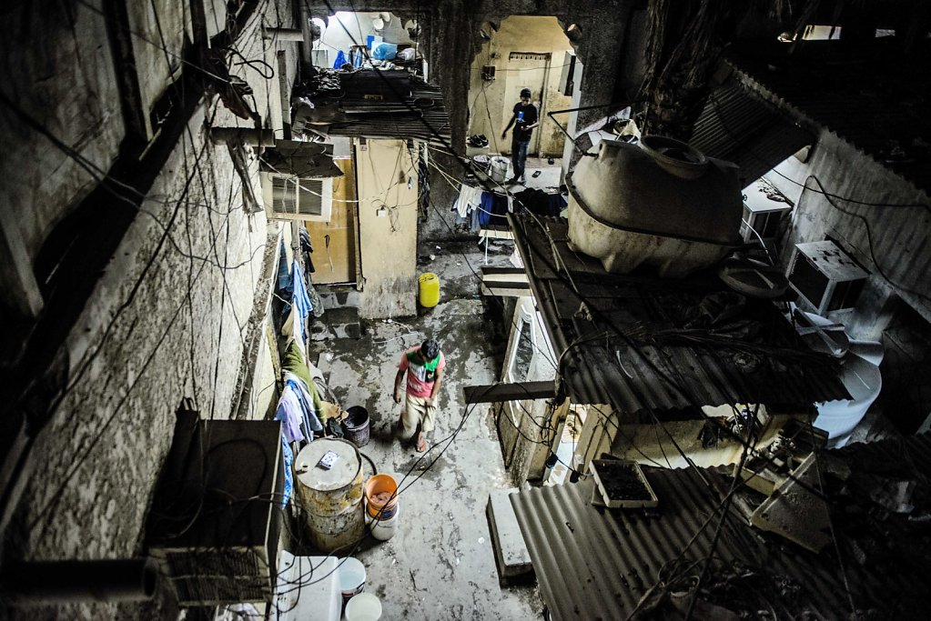 """""""We can only stay here for 2 more years. Then it will also be torn down."""" In this townhouse lives about 40 men. It's located in an area with many old dilapidated buildings, all of which are rented out to migrant workers. In about two years, they may also"""