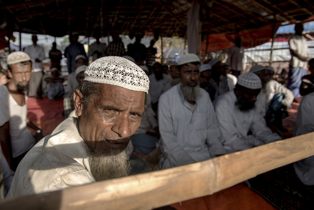 A crowd of men gathered for prayer in a bamboo mosque in Thangkhali camp
